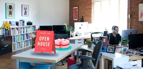 The Say Yeah office with an augmented reality open house sign